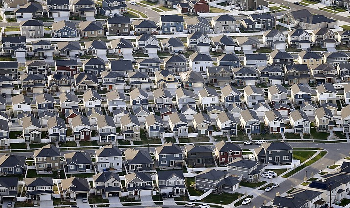 Rows of homes, are shown in suburban Salt Lake City, on April 13, 2019. Utah is one of two Western states known for rugged landscapes and wide-open spaces that are bucking the trend of sluggish U.S. population growth. The boom there and in Idaho are accompanied by healthy economic expansion, but also concern about strain on infrastructure and soaring housing prices. (AP Photo/Rick Bowmer, File)