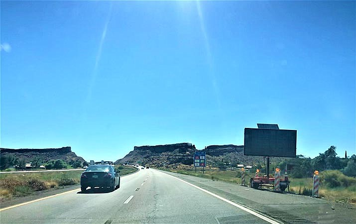 Americans, free from coronavirus confinement, are hitting the road in near-record numbers for the Memorial Day holiday. Interstate 40 in Kingman is pictured. (Miner file photo)