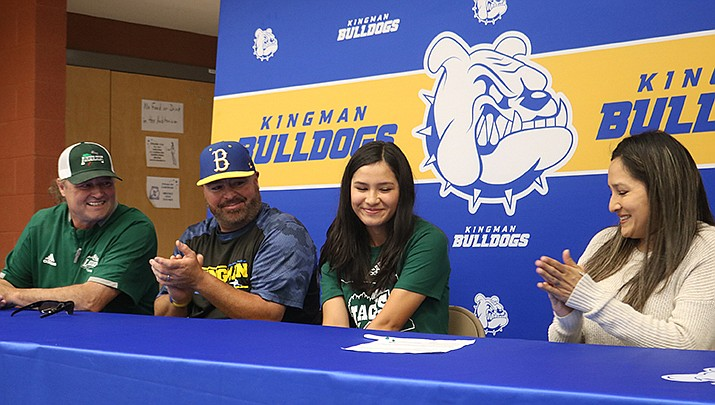 Liliana Valdivia, third from left, takes in the applause after signing her letter of intent to play college softball in North Dakota. (Photo by Travis Rains/Kingman Miner)