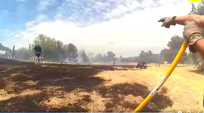 The wildfire damage can be seen from this body cam photo provided by the Yavapai County Sheriff's Office.