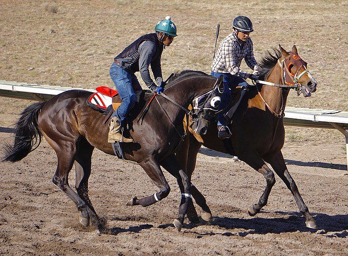 Jockeys record practice runs on their horses on Friday, May 28, 2021, at the Arizona Downs race track in Prescott Valley. (Aaron Valdez/Courier)