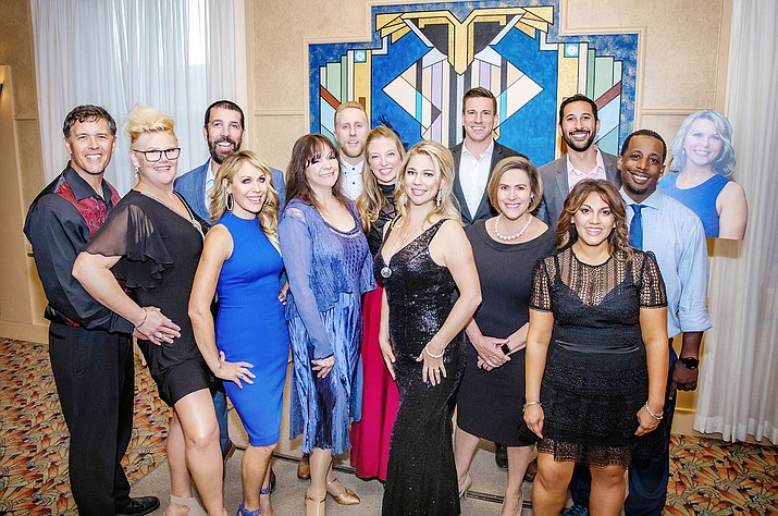 The 2021 lineup from Dancing for the Stars gathers for a group photo at the reveal party Wednesday, May 26, 2021. In the back, right is a photo cutout of Yavapai County Public Health Director Leslie Horton being held up because she was unable to attend the event. (Tracy Fultz/Courtesy)