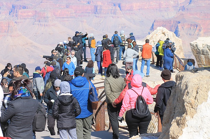 Visitors to Grand Canyon National Park can expect to see large crowds during the busier summer season and over holiday weekends. (Loretta McKenney/WGCN)