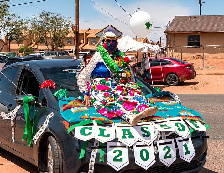 A Tuba City High School graduate prepares to receive her diploma May 29 in Tuba City. Due to COVID-19 restrictions, the 2021 graduation ceremony was held outside and live-streamed. (Photo courtesy of Gilbert Honanie)