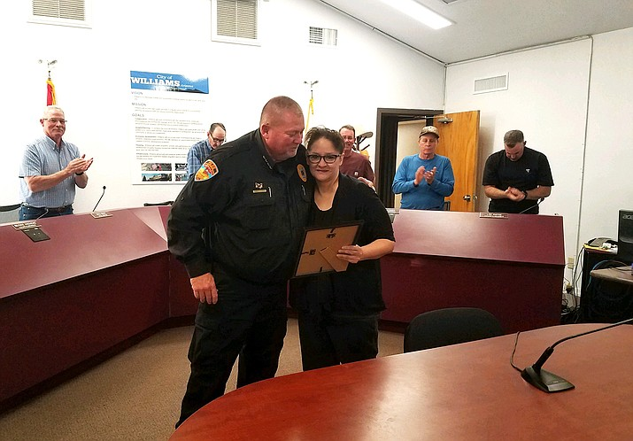 """Williams Police Chief Herman Nixon recognizes dispatcher Samantha Sandoval for actions taken during a call April 24 in which she talked a juvenile suspect out of a """"suicide by cop"""" situation. (Submitted photo)"""