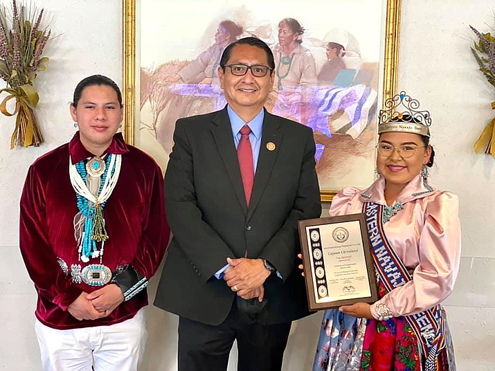 Navajo Nation President Jonathan Nez congratulates Cajaun Cleveland and Cade Allison for successfully completing the Navajo Nation Seal of Bilingual Proficiency Assessment, demonstrating their knowledge of the Navajo language May 26. (Photo/OPVP)