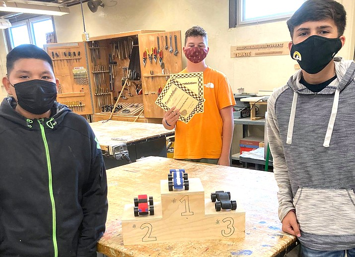 Winslow Jr. High eighth grade industrial arts students finished the semester with a wood derby car project. (Photos/Winslow Jr. High School)
