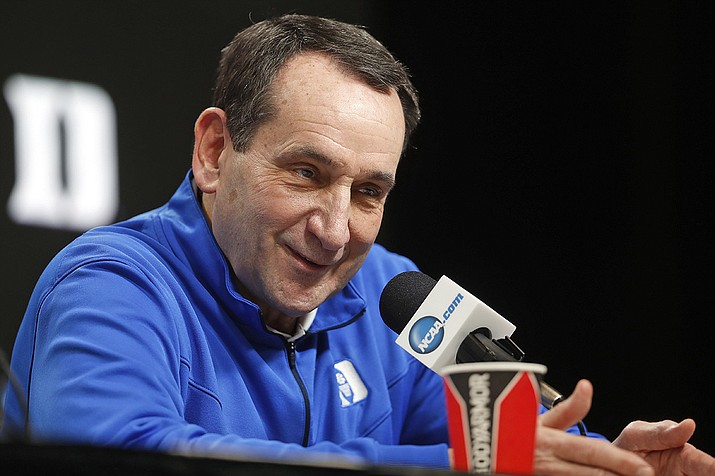 In this March 28, 2019, file photo, Duke head coach Mike Krzyzewski answers questions during a news conference at the NCAA college basketball tournament in Washington. Duke Hall of Fame coach Mike Krzyzewski will coach his final season with the Blue Devils in 2021-22, a person familiar with the situation said Wednesday, June 2, 2021. The person said former Duke player and associate head coach Jon Scheyer would then take over as Krzyzewski's successor for the 2022-23 season. (Pablo Martinez Monsivais, AP File)