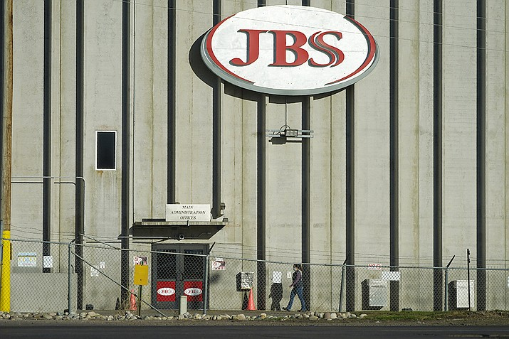 In this Oct. 12, 2020 file photo, a worker heads into the JBS meatpacking plant in Greeley, Colo. A weekend ransomware attack on the world's largest meat company is disrupting production around the world just weeks after a similar incident shut down a U.S. oil pipeline. The White House confirms that Brazil-based meat processor JBS SA notified the U.S. government Sunday, May 30, 2021, of a ransom demand from a criminal organization likely based in Russia. (David Zalubowski, File)