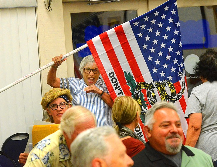 Rose Sperry waves an altered American flag at Tuesday's Cottonwood City Council meeting. The Council voted, 4-3, to approve a symbolic resolution in support of the Bill of Rights of the U.S. Constitution. VVN/Vyto Starinskas