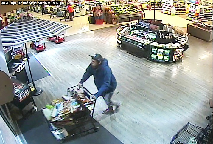 In this April 2020 photo, a man is caught on surveillance cameras walking out of the Chino Valley Safeway store with a shopping cart full of allegedly unpaid groceries worth an estimated $400. Police say that if you see someone shoplifting at a local store the best thing you can do is to not intervene and report what you saw to store employees. (Chino Valley Police Department, file)
