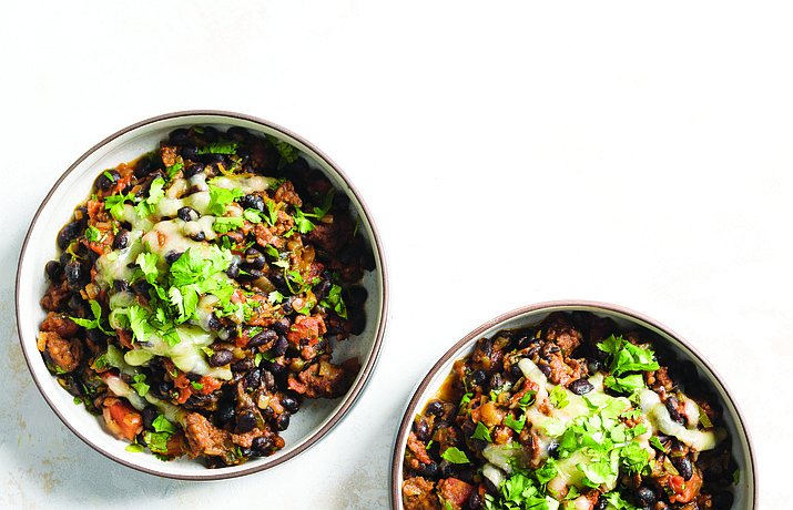 This image released by Milk Street shows a recipe for black bean stew with chorizo. (Milk Street via AP)