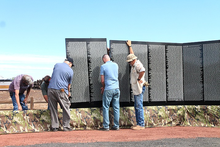 Volunteers set up The Moving Wall in Williams June 3. The Moving Wall will be on display and open to the public June 4-6 as well as Remember the Fallen, honoring military members killed in action since September 11, 2001. (Loretta McKenney/WGCN)