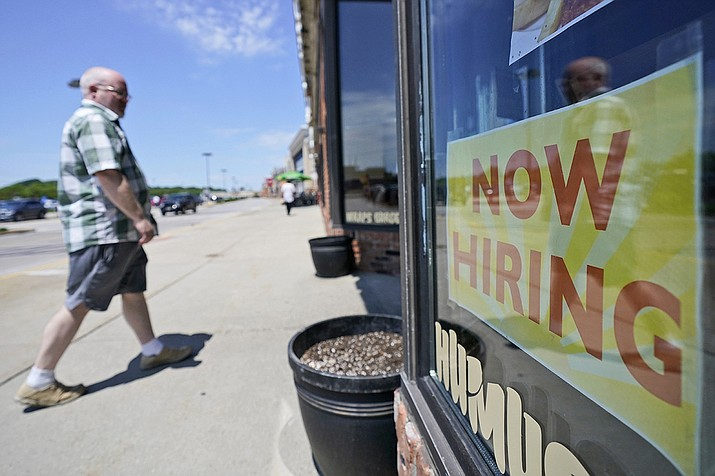 A man walks into 5th Avenue Deli and Grill, Friday, June 4, 2021, in Mayfield Heights, Ohio. Hiring in the United States picked up in May yet was slowed again by the struggles of many companies to find enough workers to keep up with the economy's swift recovery from the pandemic recession.  (Tony Dejak/AP)