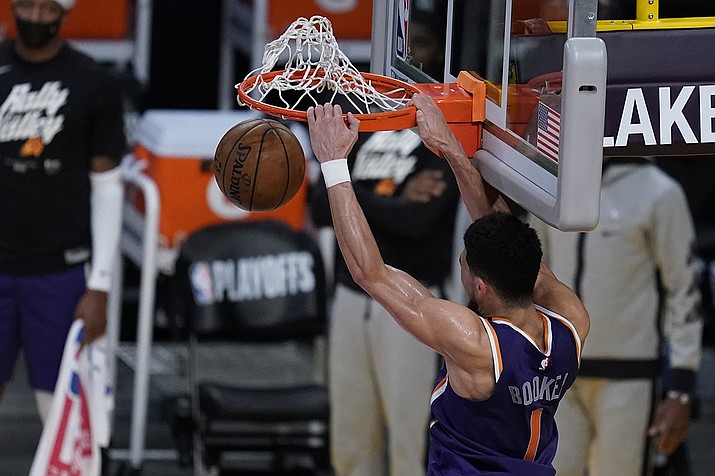 Phoenix Suns guard Devin Booker (1) dunks the ball during the fourth quarter of Game 6 of an NBA basketball first-round playoff series against the Los Angeles Lakers Thursday, June 3, 2021, in Los Angeles. (Ashley Landis/AP)
