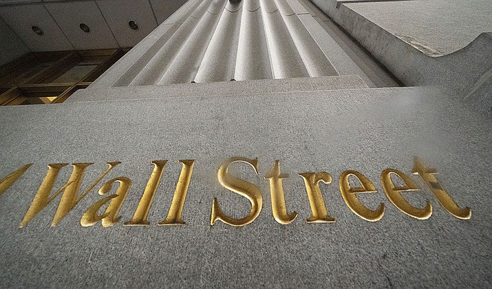 In this Nov. 5, 2020 file photo, a sign for Wall Street is carved in the side of a building, in New York. Wall Street closed out a week of mostly choppy trading with broad gains Friday, pushing the S&P 500 to its second straight weekly gain.(AP Photo/Mark Lennihan, AP File)