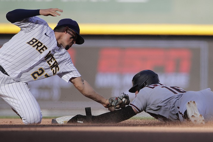 Arizona Diamondbacks' Tim Locastro (16) is caught stealing as he's tagged out at second base by Milwaukee Brewers' Willy Adames during the eighth inning of a baseball game Saturday, June 5, 2021, in Milwaukee. (Aaron Gash/AP)