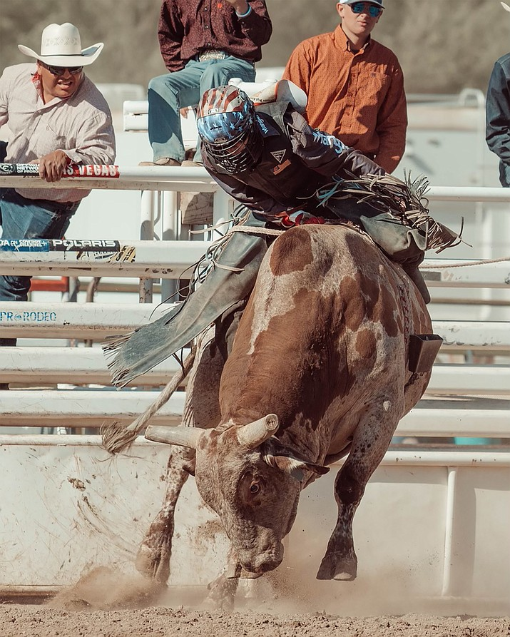 Jake Mortensen of Paulden makes a ride in bull riding on Saturday afternoon, June 5, 2021, in the Arizona High School Finals Rodeo at the Prescott Rodeo Grounds. (Kaila Baril, Still Western Photography/Courtesy)