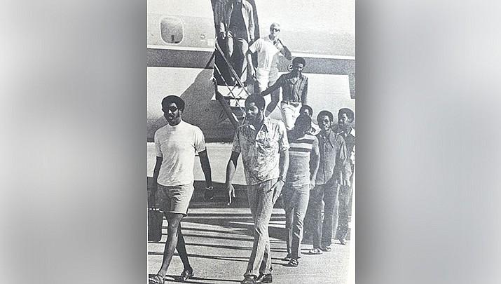 Members of the 1971-72 Phoenix Suns walk off the plane to open NBA training camp in Lake Havasu City. (News Herald file photo)