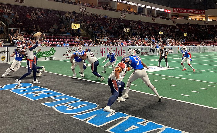 The Spokane Shock and quarterback Charl McCullum (throwing) led the Northern Arizona Wranglers, 15-3, at halftime as of press time Saturday night, June 5, 2021, at Findlay Toyota Center in Prescott Valley. The Wranglers were seeking their first win in the third game of their inaugural Indoor Football League (IFL) season. The Shock won 42-24. (Doug Cook/Courier)