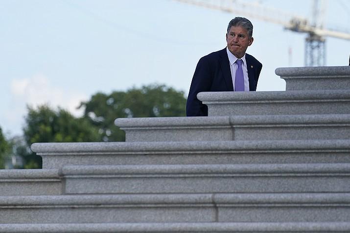 Sen. Joe Manchin, D-W.Va., walks up the steps of Capitol Hill in Washington, Monday, June 7, 2021. (Susan Walsh/AP)
