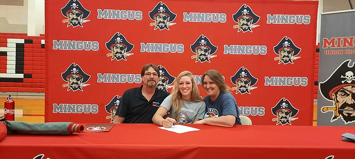 Mallorie Copeland smiles as her parents, Sandy and Richard, join her as she signs a letter of intent to attend Northwestern Colorado Community College. Copeland helped the Mingus Union softball team go 18-3 and win a regional title in her just-completed senior season. VVN/Jason W. Brooks