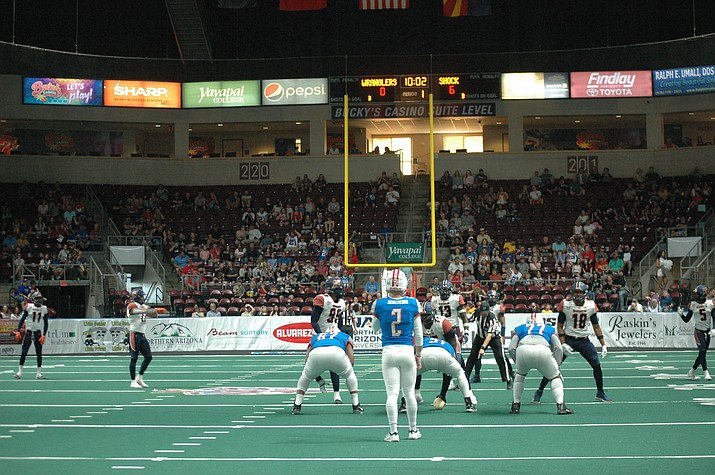 Northern Arizona Wranglers quarterback Caden Walters calls a play during the 42-24 loss to the Spokane Shock Saturday in Prescott Valley. (Doug Cook/Courier)