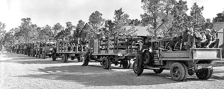 Morning line-up of Grand Canyon CCC crews ready to leave for the job sites. July 1934. (Photo/NPS)