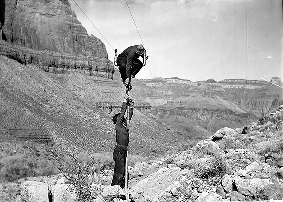 TRANS-CANYON TELEPHONE LINE CONSTRUCTION -  2 CCC ENROLLEES ATTACHING WIRE TO POLE BELOW THE REDWALL & NEAR INDIAN GARDENS. ONE MAN IS BALANCING  AT THE TOP OF THE POLE..CIRCA 1935. NPS PHOTO BY ED LAWS. GRAND CANYON NATIONAL PARK MUSUEM COLLECTION, P.O. BOX 129, GRAND CANYON, AZ 86023..
