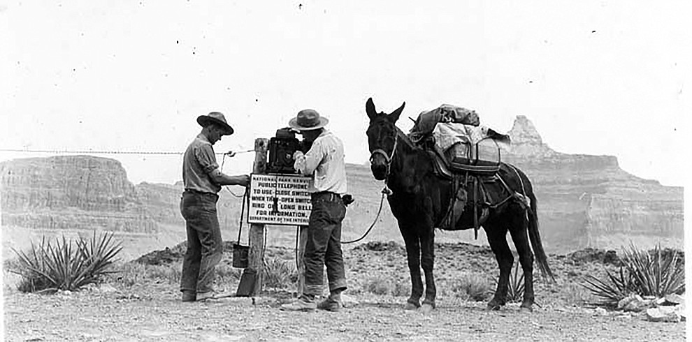 MEN WORKING ON AN EMERGENCY PHONE ON THE  S KAIBAB TRAIL, TONTO PLATEAU. DETAIL OF INSTRUCTIONAL  SIGN. CIRCA 1937. NPS PHOTO GRAND CANYON NATIONAL PARK MUSUEM COLLECTION, P.O. BOX 129, GRAND CANYON, AZ 86023