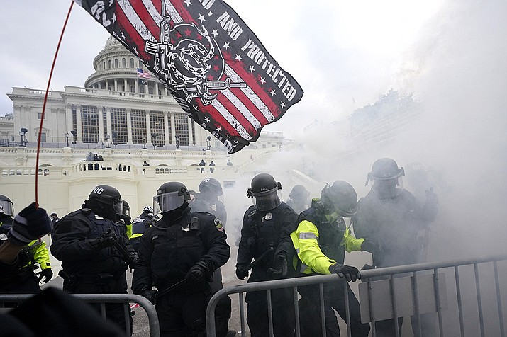 In this Jan. 6, 2021, U.S. Capitol Police officers hold off rioters loyal to President Donald Trump at the Capitol in Washington. (Julio Cortez, AP File)