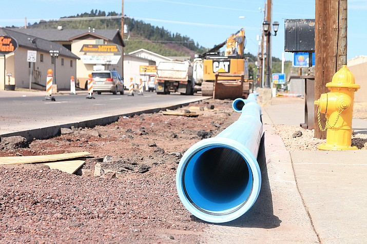 A new section of pipe for the Dogtown water line is installed in downtown Williams. (Loretta McKenney/WGCN)