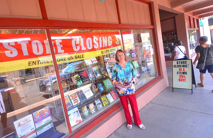 Ranney Moss, owner Adventure Unlimited Books, outside of her store on Saturday. VVN/Vyto Starinskas