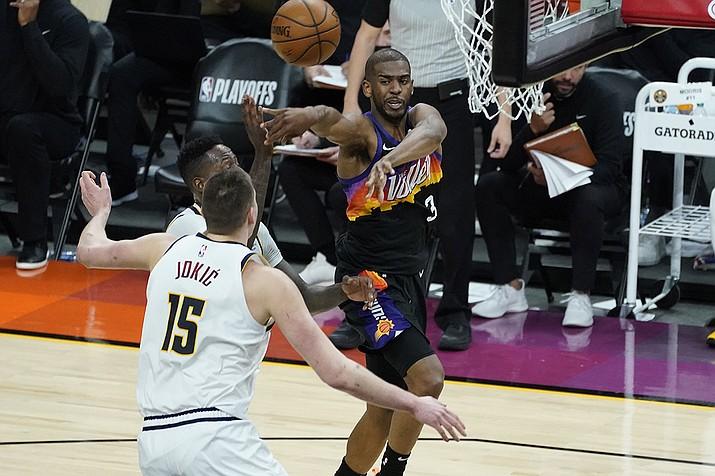 Phoenix Suns guard Chris Paul (3) passes as Denver Nuggets center Nikola Jokic (15) defends during the second half of Game 1 of an NBA basketball second-round playoff series, Monday, June 7, 2021, in Phoenix. (Matt York/AP)