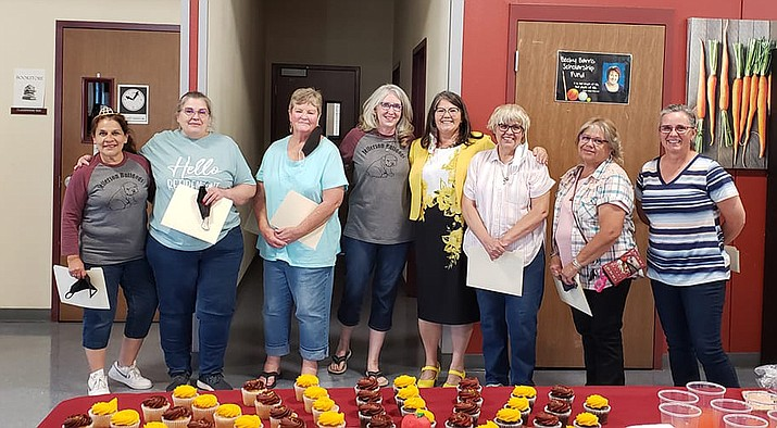 Winslow Unified School District honored several recent retirees May 20.  From left: Linda McKinney, Linda Guerrero, Cindy Greer, Sharon Pugh, Superintendent Connie Gover (not retiring), Jeanette Holt, Theresa Pacheco, and Desiree Bengson. Not pictured Jenny Decker and Beatrice Sanchez. (Photo/Winslow Unified School District)