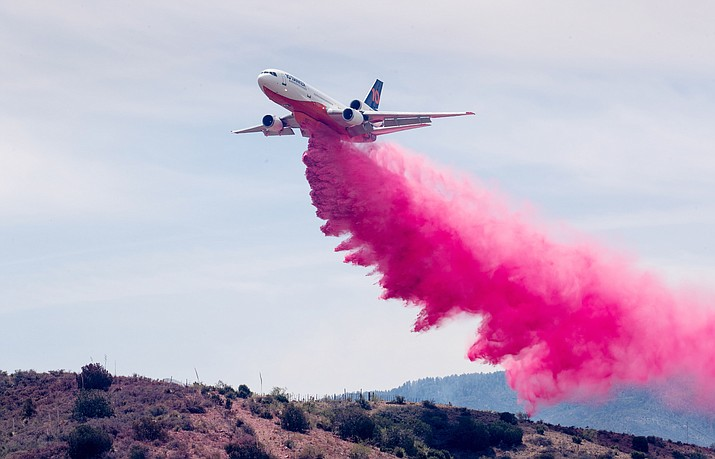 An air tanker drops slurry on the Telegraph fire June 7, 2021, in Miami, Arizona. On Tuesday, June 8, Prescott and Yavapai County area officials implemented Stage II fire restrictions, which are slated to begin at 8 a.m. Friday, June 11. (Mark Henle/The Arizona Republic via AP)