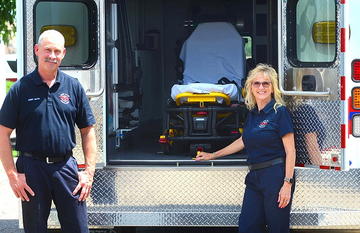 Kim Moore, outgoing chief Verde Valley Ambulance and new Chief David Guth,pose for a photo on Thursday at the ambulance service. VVN/Vyto Starinskas