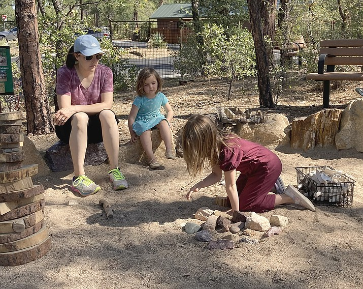 Our daughter in law and granddaughters enjoying the Forest Play area in the Discovery Gardens at the Highlands Center for Natural History. (Eric Moore/Courtesy)