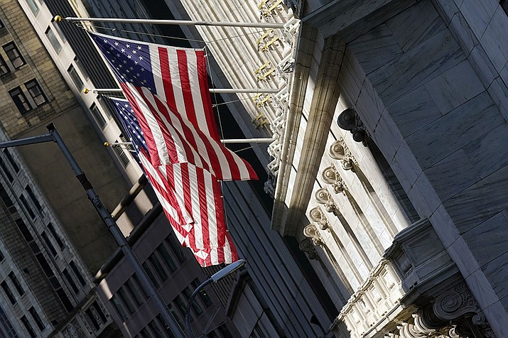 U.S. flags fly from the facade of the New York Stock Exchange, Monday, June 7, 2021. Stocks are opening mostly higher on Wall Street as gains for Big Tech companies offset weakness in banks and other parts of the market. The S&P 500 edged up 0.1% in the early going Wednesday, June 9. (Richard Drew/AP)