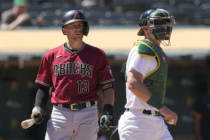 Oakland Athletics catcher Sean Murphy, right, walks toward the mound as Arizona Diamondbacks' Nick Ahmed (13) reacts to striking out for the final out in the Athletics' 4-0 win in a baseball game Wednesday, June 9, 2021, in Oakland, Calif. (Tony Avelar/AP)