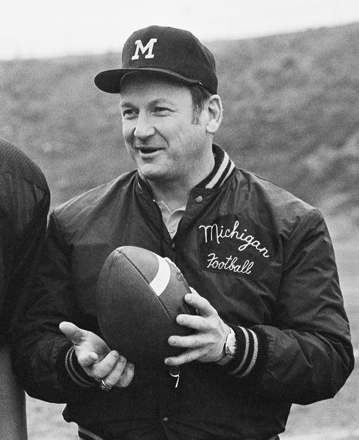 In this Dec. 21, 1977, file photo, Michigan football coach Bo Schembechler is seen during picture day at Citrus College in Azusa, Calif. Matt Schembechler, a son of the legendary coach, was among the hundreds of men who were sexually assaulted by a campus doctor, and he will speak publicly about the abuse along with two players who also were victims in the 1970s and '80s, lawyers said Wednesday, June 9, 2021. (AP Photo/AP file)
