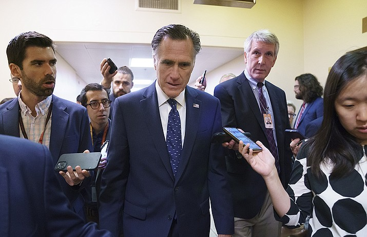 Sen. Mitt Romney, R-Utah, is surrounded by reporters as he walks to the Senate chamber for votes, at the Capitol in Washington, Thursday, June 10, 2021. Sen. Romney is working with a bipartisan group of 10 senators negotiating an infrastructure deal with President Joe Biden. (AP Photo/J. Scott Applewhite/AP)