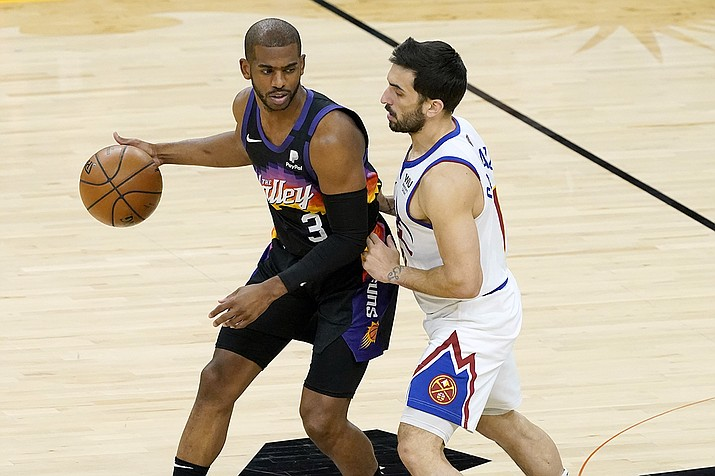 Phoenix Suns guard Chris Paul (3) is defended by Denver Nuggets guard Facundo Campazzo during the first half of Game 2 of an NBA basketball second-round playoff series, Wednesday, June 9, 2021, in Phoenix. (Matt York/AP)
