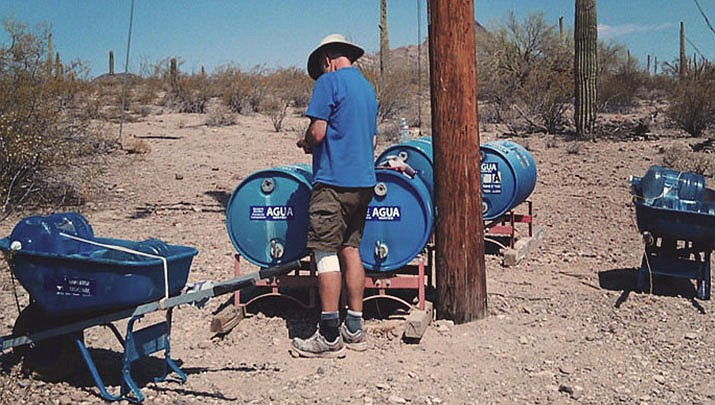 A volunteer from the Humane Border group refills water stations in the desert near the U.S.-Mexico border. (Photo by Humane Borders, cc-by-sa-4.0, https://bit.ly/352dXp4)