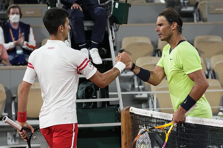 Serbia's Novak Djokovic, left, shakes hands with Spain's Rafael Nadal after their semifinal match of the French Open tennis tournament at the Roland Garros stadium Friday, June 11, 2021 in Paris. Novak Djokovic won 3-6, 6-3, 7-6 (4), 6-2. (Michel Euler/AP)