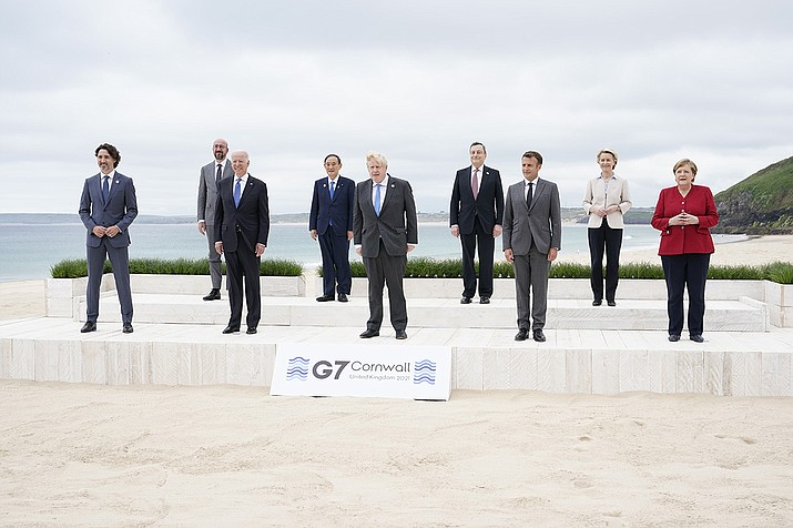 Leaders of the G7 pose for a group photo on overlooking the beach at the Carbis Bay Hotel in Carbis Bay, St. Ives, Cornwall, England, Friday, June 11, 2021. Leaders from left, Canadian Prime Minister Justin Trudeau, European Council President Charles Michel, U.S. President Joe Biden, Japan's Prime Minister Yoshihide Suga, British Prime Minister Boris Johnson, Italy's Prime Minister Mario Draghi, French President Emmanuel Macron, European Commission President Ursula von der Leyen and German Chancellor Angela Merkel. (/Patrick Semansky, AP Pool)