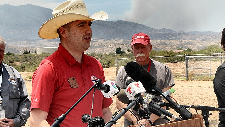 With smoke from the Telegraph Fire rising in the background, Sen. T.J. Shope on Thursday, June 10 discusses plans for a special legislative session to deal with wildfires. (Photo by Howard Fischer/For the Miner)