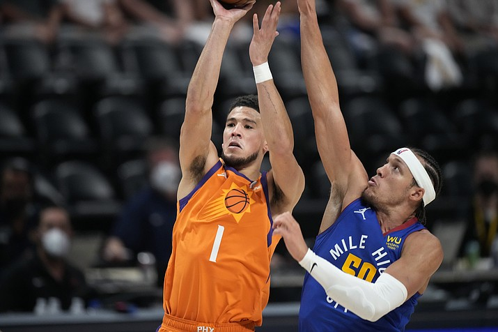 Phoenix Suns guard Devin Booker shoots as Denver Nuggets forward Aaron Gordon defends during the first half of Game 3 of an NBA second-round playoff series Friday, June 11, 2021, in Denver. (David Zalubowski/AP)