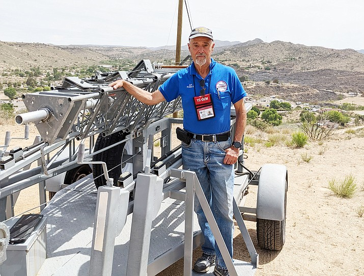 Art Protas, a member of the Amateur Radio Emergency Service, stands by the backup relay tower that he and Rusty Evenson transported to Bagdad to help with communications during the Spur Fire. (Don Bauer/Courtesy)