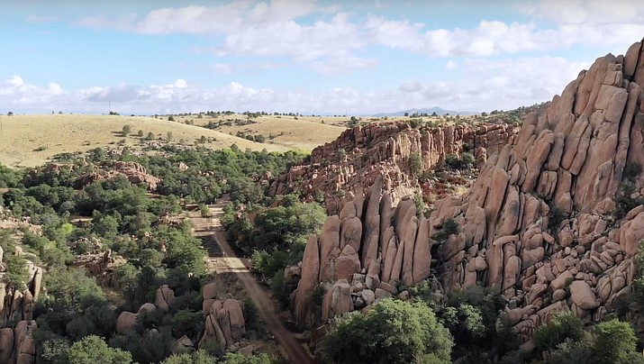"""This undated image from drone footage shows the Dells area in Prescott with the """"Point of Rocks"""" prominently visible in the foreground. The City of Prescott announced the public will have a chance to weigh in on the Arizona Eco Development (AED) plans during a Prescott City Council study session this week. A study session is scheduled for 1 p.m. Tuesday, June 15, with just one item on the agenda: the pre-annexation development agreement for AED. The development agreement states: """"The city desires to own, for purposes of public open space, a portion of the Granite Dells including the Point of Rocks which is located with the south parcel."""" (Image from video provided by Arizona Eco Development/Courtesy)"""